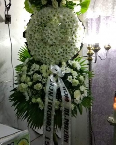 A Funeral Wreath of Round white